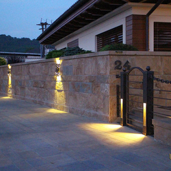 Entrance lighting in a wrought iron fence and luxury lights Bark