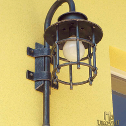 A side wrought iron light - a luxurious exterior lamp from UKOVMI