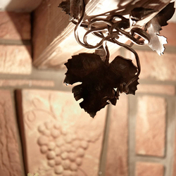 A wrought iron lamp - a vine leaf