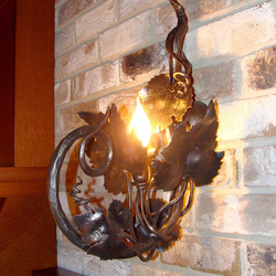 A side wrought iron cellar lamp