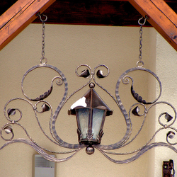 A wrought iron lamp - house entrance