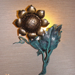A sunflower as a side lamp - hand forged lighting
