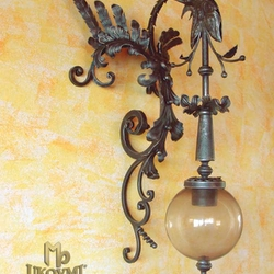 A wrought iron dragon as a light