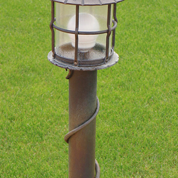A wrought iron garden lamp with glass