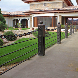 A wrought iron railing with built-in lighting