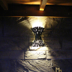 A wrought iron lamp shade - a luxurious light