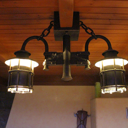 Wrought iron lighting in a summer house - luxury lights
