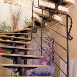 A wrought iron stair railing - Plaits pattern