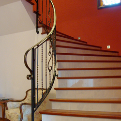 A spiral wrought iron stair railing