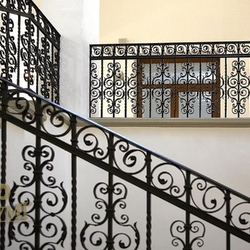 A wrought iron railing of the 15th-century building