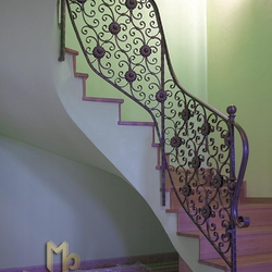 A wrought iron stair railing