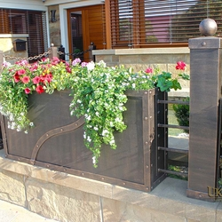 A wrought iron fence with flowerpots