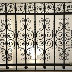 A wrought iron railing in a historical building from the 15th century