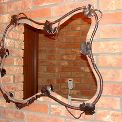 A wrought iron mirror frame - luxury mirrors