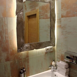 A unique stainless steel mirror in the bathroom