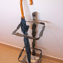 A wrought iron umbrella holder