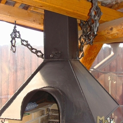 A wrought iron fireplace set