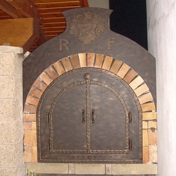 A wrought iron door for a pizza oven