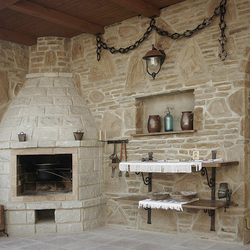 A hint of the Middle Ages - wrought iron fireplace accessories for a summer house