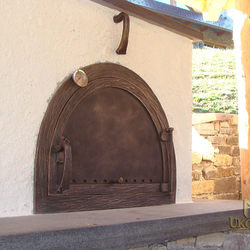 A wrought iron door for a clay stove