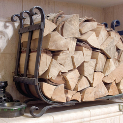 A wrought iron firewood rack