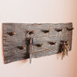 A wrought iron key hanger - wrought iron furniture