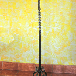 A rustic wrought iron hanger