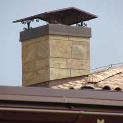 A wrought iron chimney roof