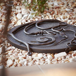A wrought iron well cover