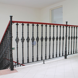 A historical forged railing - Cast iron railings with a wooden handrail in a historic house from the 16th century