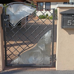 A modern wrought iron gate - stainless steel - iron combination