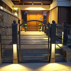 Modern entrance lighting of a wrought iron fence - luxury lights