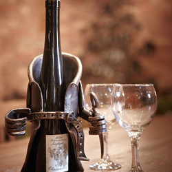 A wrought iron wine holder - a present