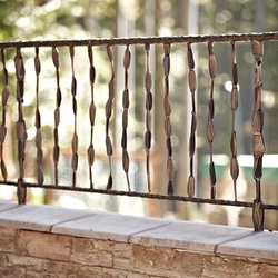 A wrought iron railing on a terrace
