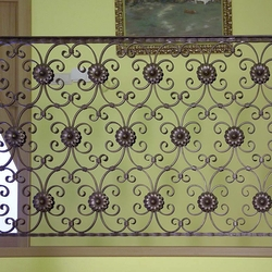 A wrought iron railing - gallery