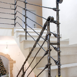 A wrought iron stair railing - Knot pattern